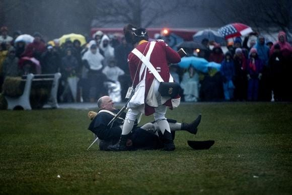 A Minute Man gets bayoneted by a British Regular during the reenactment of the Battle of Lexington on Patriots' Day 2018. The iconic reenactment will not take place in 2021 due to the COVID-19 pandemic.