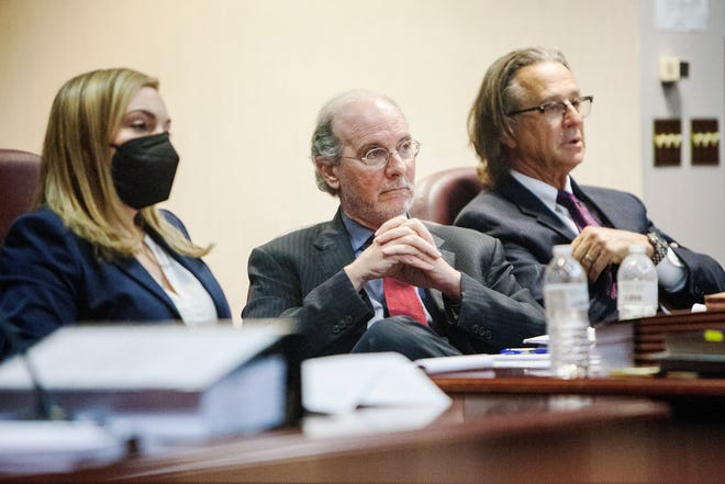 Independent counsel James Cooney III, center, and Ike Northrup, right, listen to witness testimony during the removal hearing of District Attorney Greg Newman.