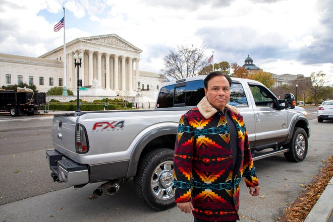 This undated image provided by the Institute for Justice shows Gerardo Serrano outside the Supreme Court building in Washington. Serrano ticked off the border crossing agents by taking some photos on his phone. So they took his pickup truck and held onto it for more than two years. Only after Serrano filed a federal lawsuit did he get back his Ford F-250. Now he wants the Supreme Court to step in and require a prompt court hearing as a matter of constitutional fairness whenever federal officials take someone's property under civil forfeiture law.