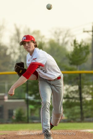 Walker Smallwood fires a pitch for Dixie Heights against Villa Madonna Tuesday, April 6, 2021.