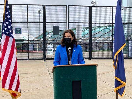 Gov.  Gretchen Whitmer speaks outside a mass vaccination site at the Eastern Michigan University Convocation Center on April 12, 2021. She renewed requests for more vaccines from the federal government and asked Michigan residents to act responsibly to end the latest pandemic wave.