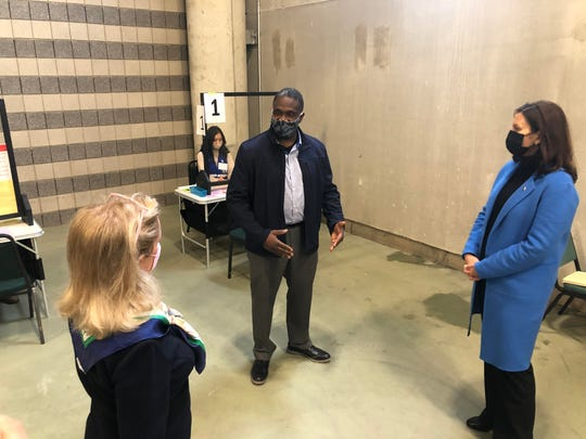 Kevin Lawson, 51 from Ypsilanti, speaks with rep.  Debbie Dingell and Government Gretchen Whitmer before receiving his COVID-19 vaccine at the Eastern Michigan University Convocation Center on April 12, 2021.