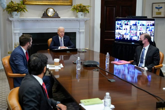 President Joe Biden participates virtually in the CEO Summit on Semiconductor and Supply Chain Resilience in the Roosevelt Room of the White House, Monday, April 12, 2021, in Washington. Seated with Biden are Daleep Singh, Deputy National Security Adviser and Deputy Director of the National Economic Council, clockwise from bottom left, National Economic Council Director Brian Deese and National Security Adviser Jake Sullivan. (AP Photo/Patrick Semansky)