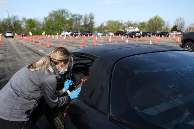 Kentucky's largest COVID-19 vaccination site opens in the parking lot at U of L's Cardinal Stadium on April 12, 2021. The site will be available for seven weeks for vaccinations.