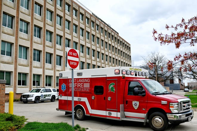 Police and fire personnel on the scene after an unintended chemical reaction injured two people on Monday, April, 12, 2021 in a chemistry lab on Michigan State University's campus.