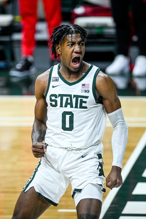 Michigan State's Aaron Henry celebrate after a dunk against Ohio State during the first half on Thursday, Feb. 25, 2021, at the Breslin Center in East Lansing.