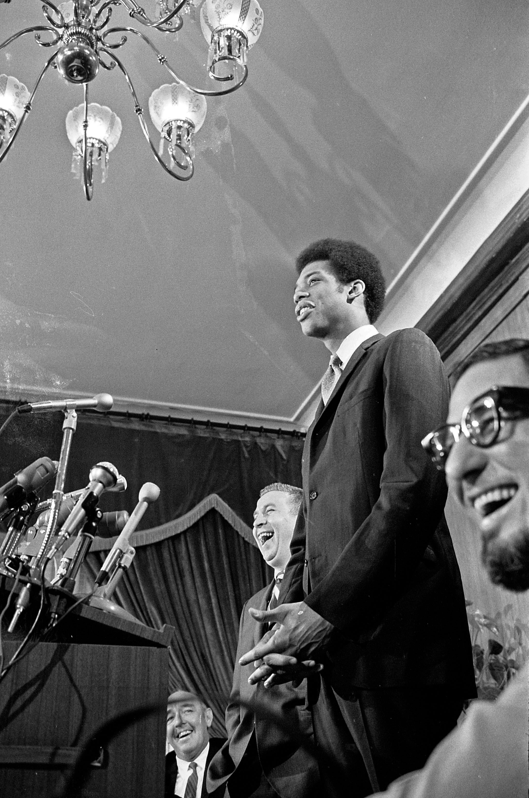 Lew Alcindor (who later changed his name to Kareem Abdul-Jabbar) waits to be introduced by the Milwaukee Bucks during a news conference at the Pfister Hotel in April 1969.