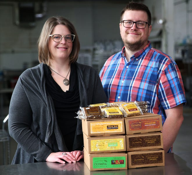 Dana Herdeman and her husband, A.J. Girard, display their company's Olympia Granola Bars on Monday. The couple recently moved from Green Bay to bring their business to Milwaukee's Riverwest neighborhood.