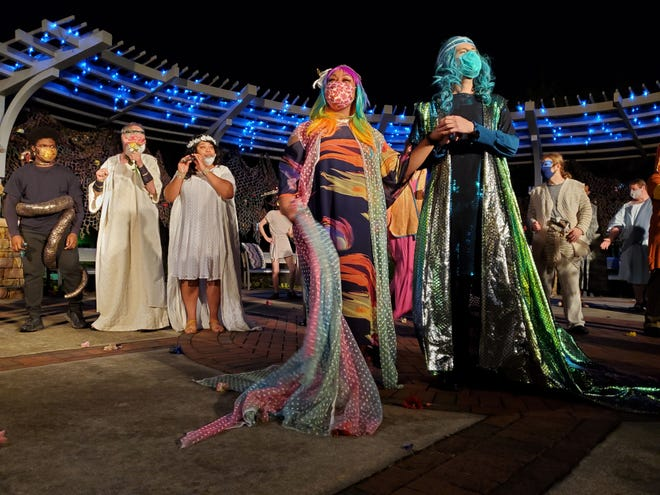 """The actors are beautifully costumed, well lit and masked in AUM's ongoing production of Shakespeare's """"A Midsummer Night's Dream."""""""