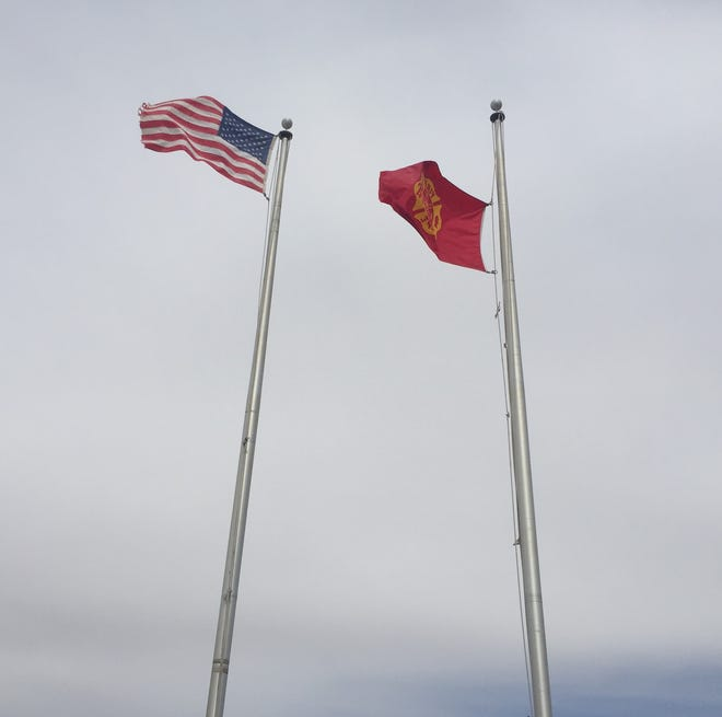 Flags fly high at the Sun Country Volunteer Fire Department on April 12, 2021 near Artesia.