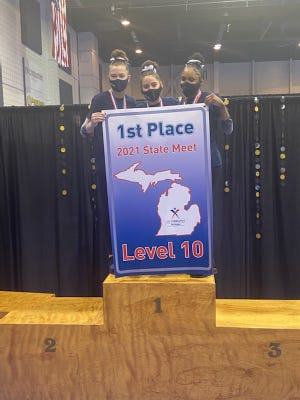 Ella Chemotti, Nikki Smith and Sophia Reddy celebrate their first-place finish at the 2021 Level 10 state finals for EuroStars Gymnastics.