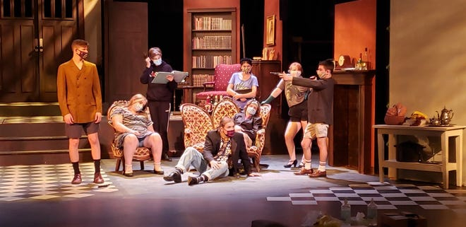 """The Red cast of Stage One Youth Theatre's production of """"Clue!"""" includes Ethan Bain (from left), Jenna Larsen, Caleb Haager, Luke Sheridan, Avery Walther, Braidan Denton, Livi Hand and Ross Fogle."""