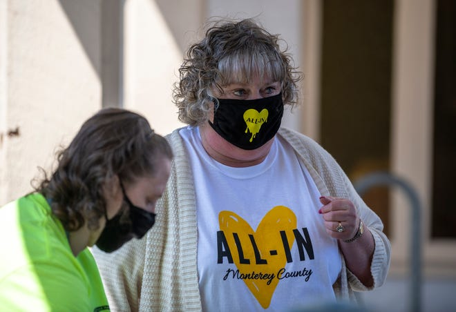 Natalie Zwingman, wears and All-In Monterey County mask and shirt during a mobile vaccine clinic at First United Methodist Church in Salinas Calif., on Friday, April 9, 2021. Central Avenue Pharmacy and All-In Monterey teamed up to provide dozens of vaccines during this mobile vaccination clinic.