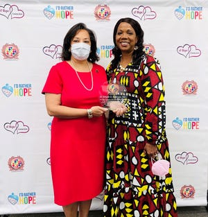 Dr. Temple O. Robinson, MD, Bond Community Health Center, left, with Rosalind Tompkins is one of the recipients of the National Month of Hope awards given out on April 8, 2021.