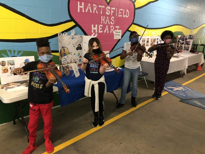 Hartsfield Elementary violin students inspired by Black Violin's virtual concert performed a surprise show for classmates. Hartsfield is one of the 22 Title I schools that participated in the Opening Nights in Class free program to inspire students and help build their self-confidence.