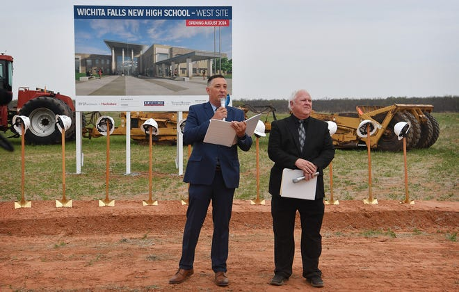 Wichita Falls ISD Superintendent Michael Kuhrt, left, and pastor Mike Rucker speak at the West site location of the two new high schools to be constructed over the next three years as shown in this April 21, 2021, file photo.