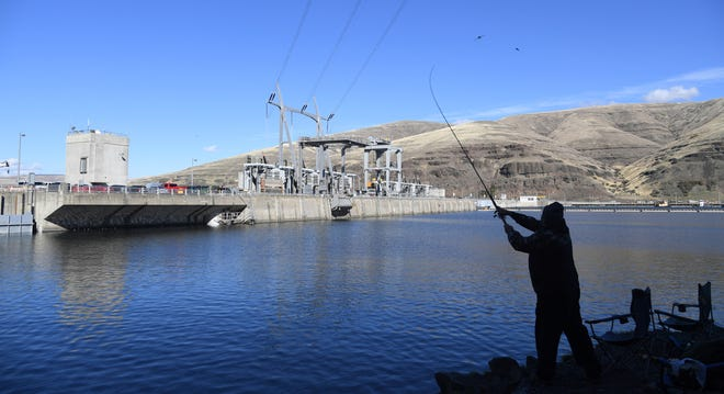 A man fishes for salmon in the Snake River above the Lower Granite Dam on Oct. 19, 2016, in Washington. The Snake River was named the nation's most endangered river by the environmental group American Rivers.