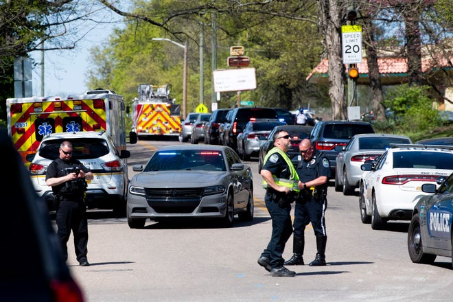 Police work in the area of Austin-East Magnet High School after a reported shooting April 12, 2021.