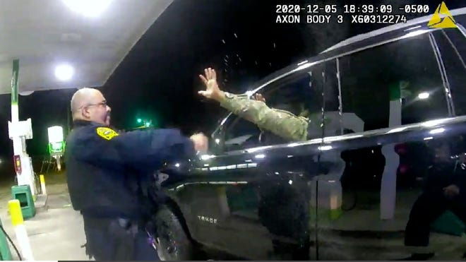 In this image made from Windsor Police video, a police officer uses a spray agent on Caron Nazario on Dec. 20, 2020, in Windsor, Va.