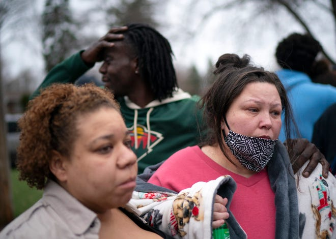 April 11, 2021: Friends and family comfort Katie Wright, right, while she speaks briefly to news media near where her son Daunte Wright, 20, was shot and killed by police in Brooklyn Center, Minn.