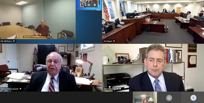In still frame taken from video, Harvey Weinstein, upper left, appears via video from prison before Erie County Judge Kenneth Case, top right, as his attorney, Norman Effman, lower left, speaks and Los Angeles based defense attorney Mark Werksman listens in, April 12, 2021, in Buffalo, N.Y.