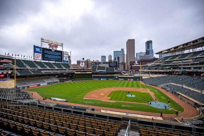 Signage on the Target Field video board shows that Monday's game between the Boston Red Sox and Minnesota Twins is postponed.
