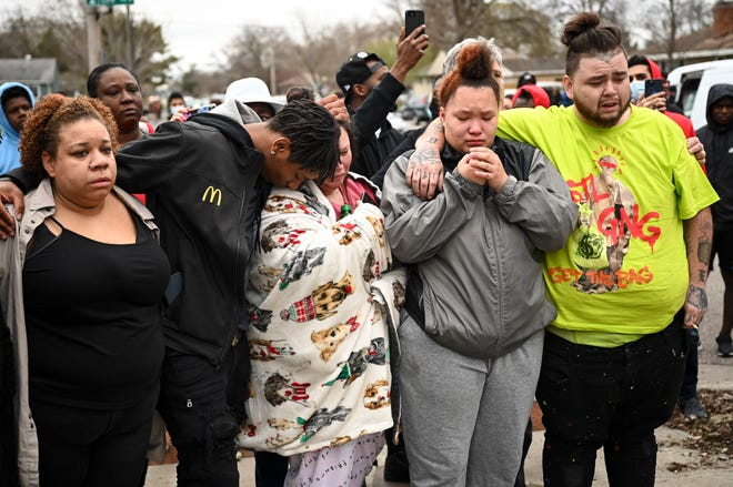 Family and friends of Daunte Wright, 20, grieve at 63rd Avenue North and Lee Avenue North hours after they say he was shot and killed by police, Sunday, April 11, 2021, in Brooklyn Center, Minn. Wright's mother, Katie Wright, stands at center.