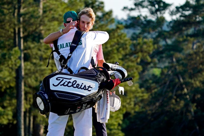 Will Zalatoris hugs his caddie Ryan Goble on the 18th green in the final round of The Masters.