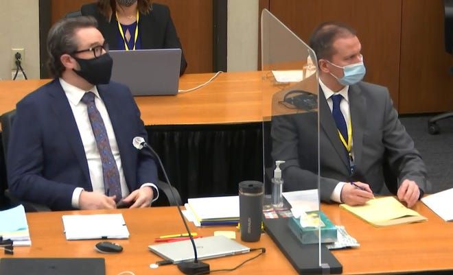 In this image from video, defense attorney Eric Nelson, left, and defendant, former Minneapolis police officer Derek Chauvin, right, listen Monday, April 12, 2021.