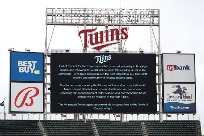 A message on the video board displays a game postponement between the Red Sox and Twins at Target Field.