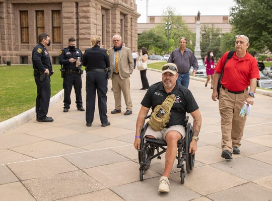 Firearm instructors Jorge De Leon, left to right, Lon Krieger and Raul Camacho spoke against bills that would dismantle the Texas License to Carry program at news conference the Capitol on Tuesday April 13, 2021.