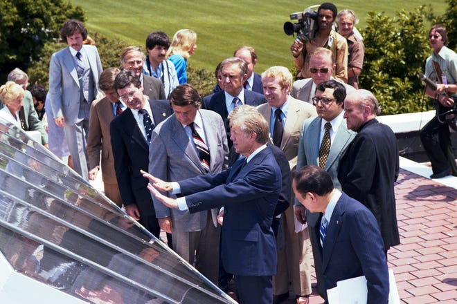 This archival photo from June 1979 shows President Jimmy Carter unveiling 32 thermal solar panels on the roof of the West Wing of the White House.