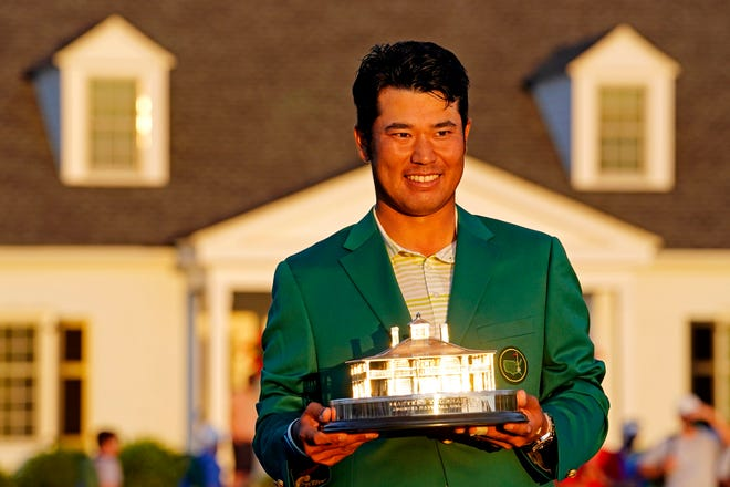 Apr 11, 2021; Augusta, Georgia, USA; Hideki Matsuyama celebrates with The Master trophy after winning The Masters golf tournament. Mandatory Credit: Rob Schumacher-USA TODAY Sports