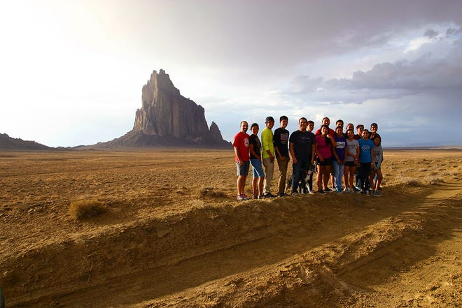 """Northern Diné Youth Committee members are shown in front of Shiprock during the filming of """"The Mayors of Shiprock."""""""