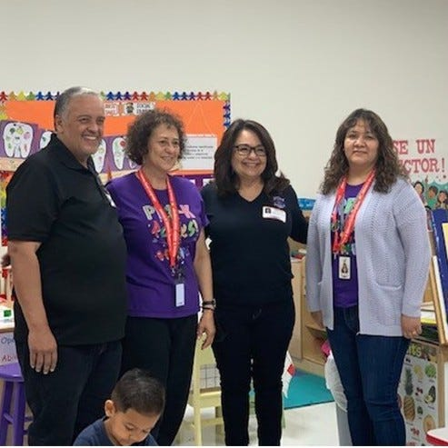 Dr. Richard Gomez (left) and his consultant Rosie Sandoval (third from left) recognizes Pre-K teacher Neyse Hall and her assistant Maria Gutierrez