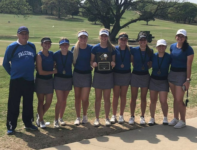 The Lady Falcons pose with their first-place trophy on Monday after winning the Lone Grove Invitational at Lake Murray Golf Course.