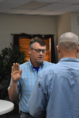 Bobby Black is sworn in as the newest member of the Dickson Board of Education Monday, April 12, 2021. Among his first votes was one to approve legal action against the State Board of Education for a March 25 vote to settle a 2017 lawsuit and change funding for charter schools.