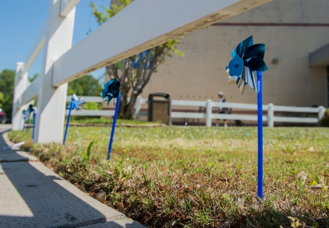 The Family Y on Wheeler Road is displaying pinwheels to bring awareness to local cases of child abuse.