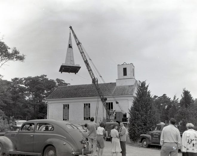 The steeple comes off the West Parish Meetinghouse during a restoration project begun in 1953 toward returning the building to its original design.