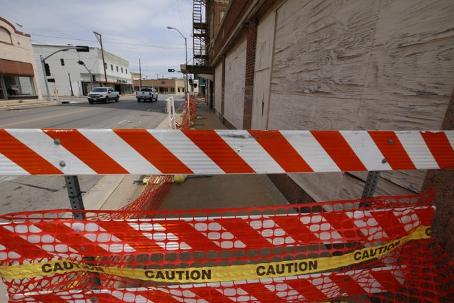 The City of Brownwood has closed off the sidewalk outside the former Brownwood Hotel.
