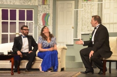 """Even though he's missing key facts, Ken Gorman (played by Nicholas Ewen), shown on the right, attempts to spin a narrative to explain the absence of their hosts at a dinner party. Fellow party guests Lenny and Claire Ganz (played by Levi Packer and Lasha Dennis), struggle to make sense of it all. The Brownwood Lyric Theatre's production of Neil Simon's """"Rumors"""" opens Friday night. Tickets and concessions to the eight-show run may be reserved online."""