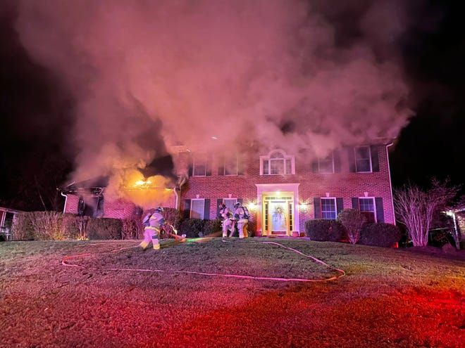 Columbia Fire Department personnel battled a fire early Tuesday on Chapel Wood Road in Columbia.