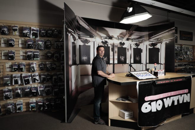 """Eric Delbert, co-owner of L.E.P.D. Firearms and Range, at his studio where he hosts a radio show inside his store. President Joe Biden has issued two executive orders on firearms, one that would help stop the proliferation of """"ghost guns,"""" or guns assembled from kits with many components needed to complete a firearm but that lack a serial number that can be used to trace the firearm, and another rule that would effectively ban the use of a stabilizing arm brace on AR-style pistols, subjecting them to the same regulations as short-barreled rifles in the National Firearms Act."""