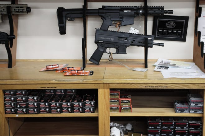 """Two AR-style pistols sit on display at L.E.P.D. Firearms, Range and Training Facility on Tuesday, Apr. 13, 2021 in Columbus, Ohio. President Biden has issued two executive orders on firearms, one that would help stop the proliferation of """"ghost guns,"""" or guns assembled from kits with many components needed to complete a firearm but that lack a serial number that can be used to trace the firearm, and another rule that would effectively ban the use of a stabalizing arm brace on AR-style pistols, subjecting them to the same regulations as short-barreled rifles in the National Firearms Act."""