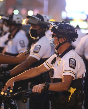 Columbus police officer shown wearing a yellow and black Taser during Black Lives Matter protest on Friday, July 31, 2020.  [Fred Squillante/Dispatch file photo]