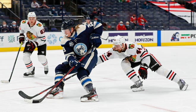 Columbus Blue Jackets right wing Patrik Laine (29) gets around Chicago Blackhawks defenseman Calvin de Haan (44) and scores a goal during the third period of their NHL game at Nationwide Arena in Columbus, Ohio on April 12, 2021.