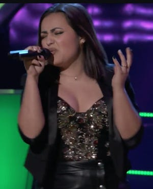 "Adrian's Rio Doyle, 16, performs the song ""Somebody That I Used to Know"" during Monday night's episode of NBC's ""The Voice."" Doyle was selected as the winner of her head-to-head singing battle, which advances her to the next round of the signing competition."
