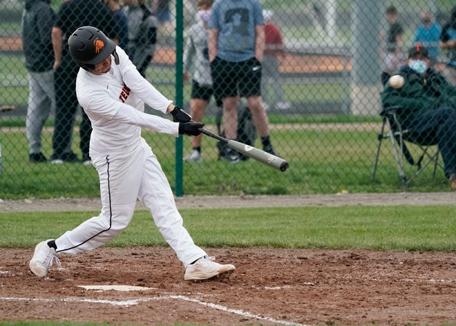Tecumseh's Jack Burnett hits a double during Monday's game against Dexter.