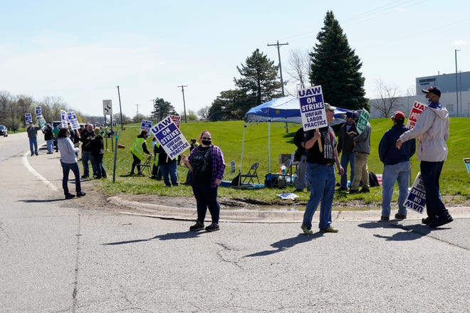 United Auto Workers Local 3000 members are seen on strike Tuesday outside the Kirchhoff Automotive plant in Tecumseh.