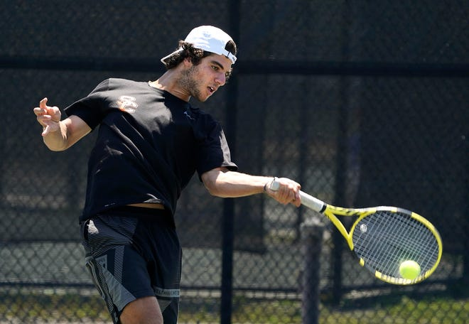 Spruce Creek's Sami Ozzor during district tennis, Tuesday, April 13, 2021.